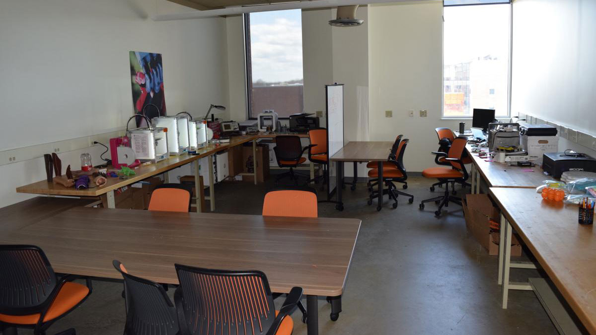lab space with several tables and chairs