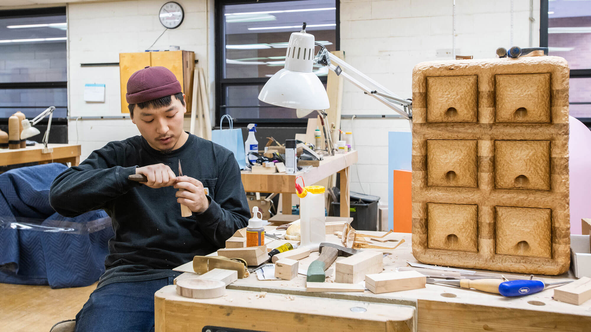 A furniture design student works on a project in one of the program's studios.