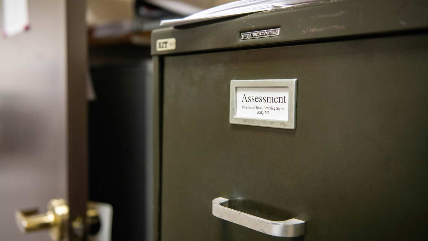 Filling cabinet with a label of Assessment