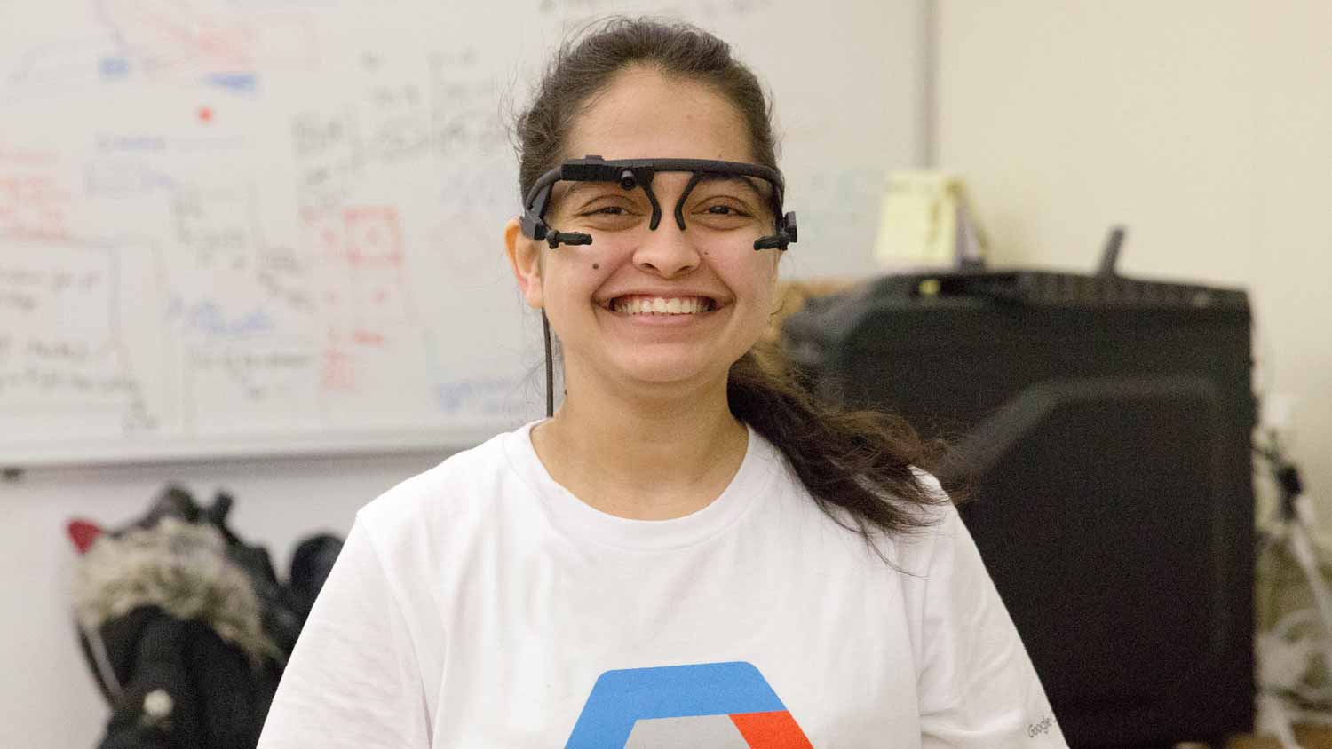 Student smiling while wearing   prototype glasses