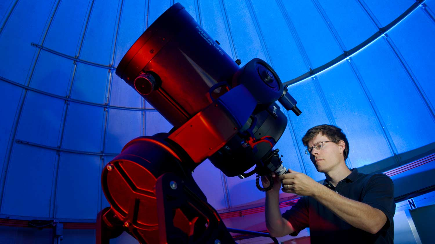 Person calibrating a telescope