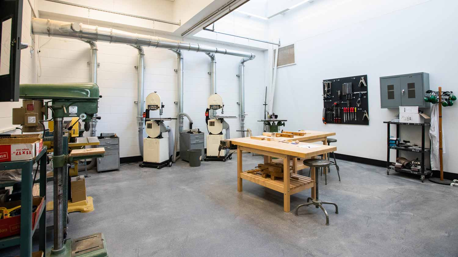 Fabrication room with bandsaws, drill presses, and other equipment