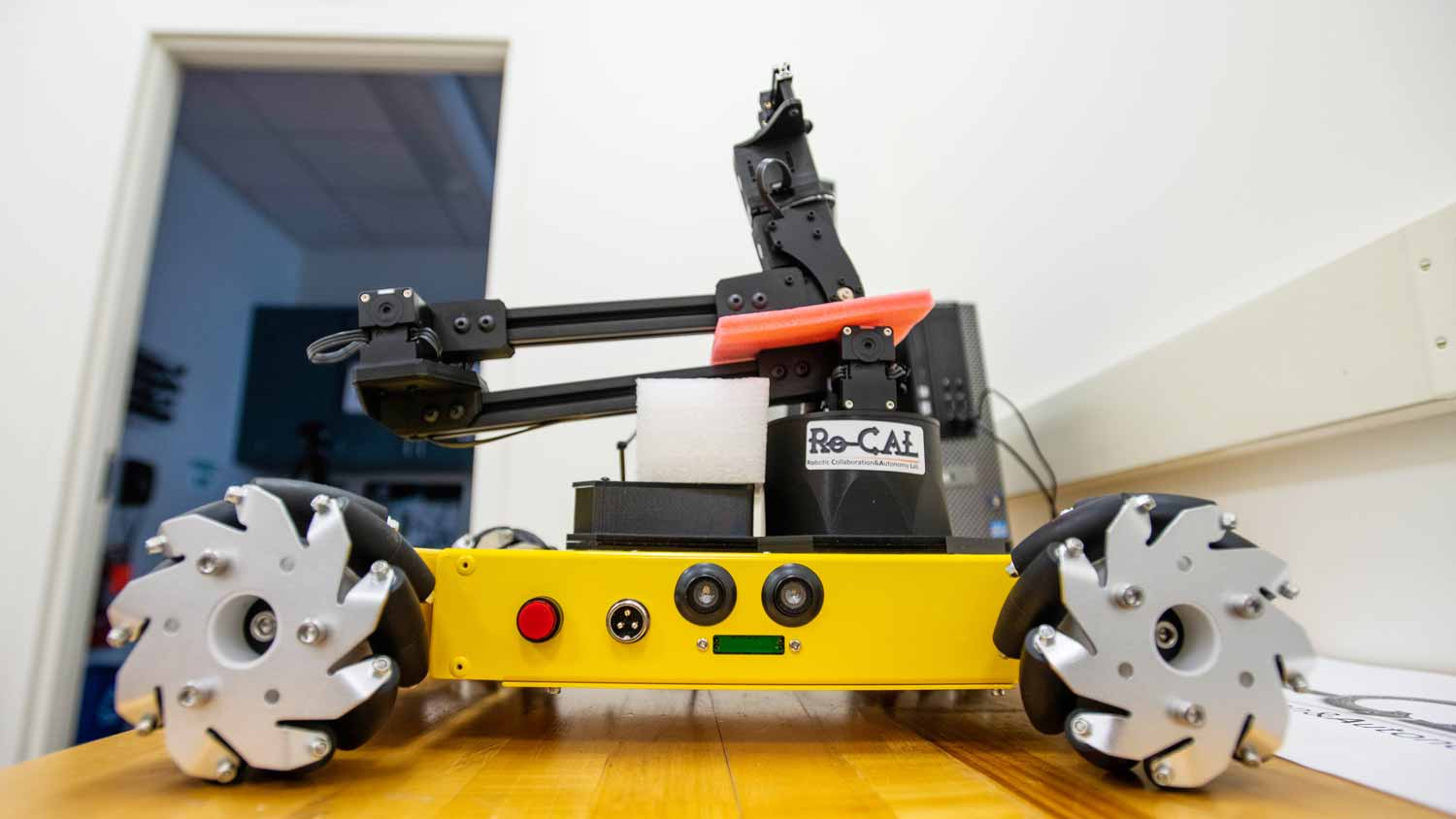 A rover like robot with an actuating arm and rubber tires