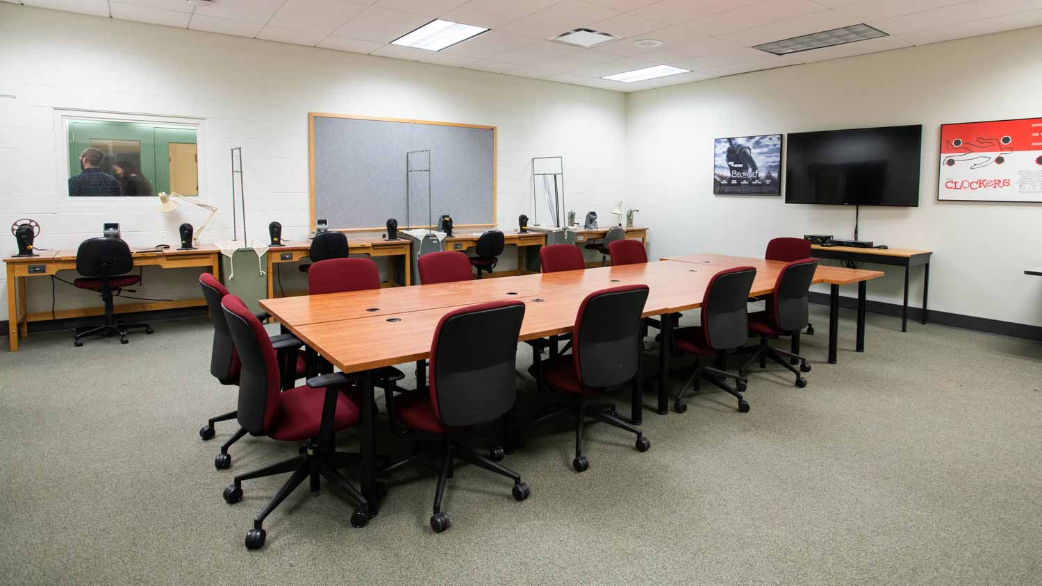 Seminar room with a large conference table facing a large TV screen