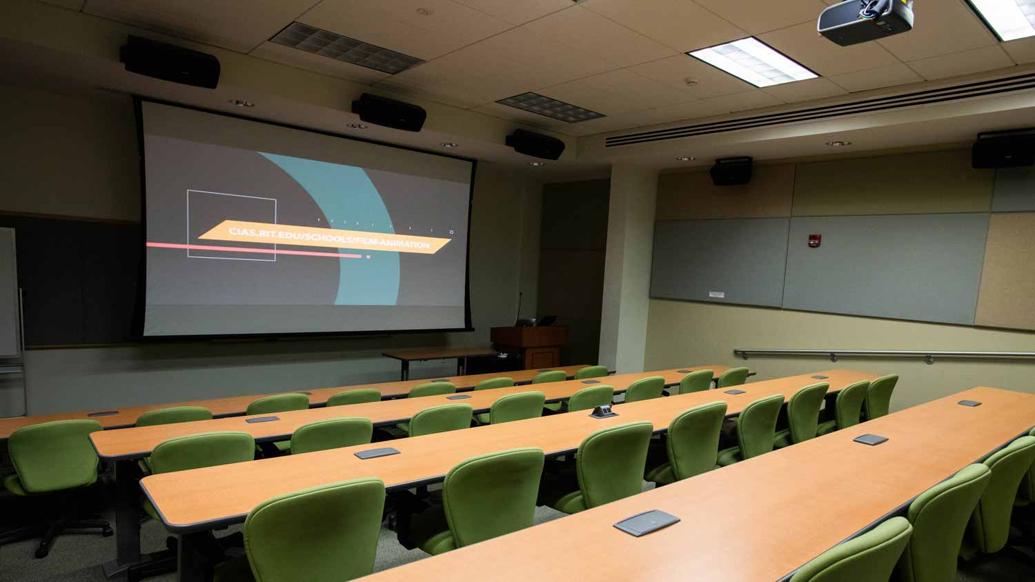 Stadium seating classroom with large projector screen