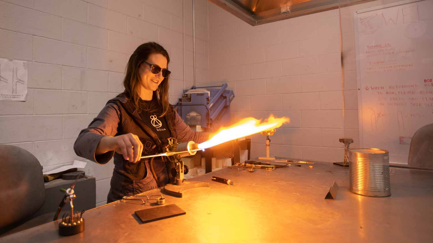 Student igniting a torch to heat metal