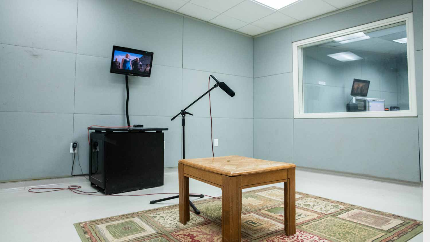 Sound recording room with an empty table on a carpet