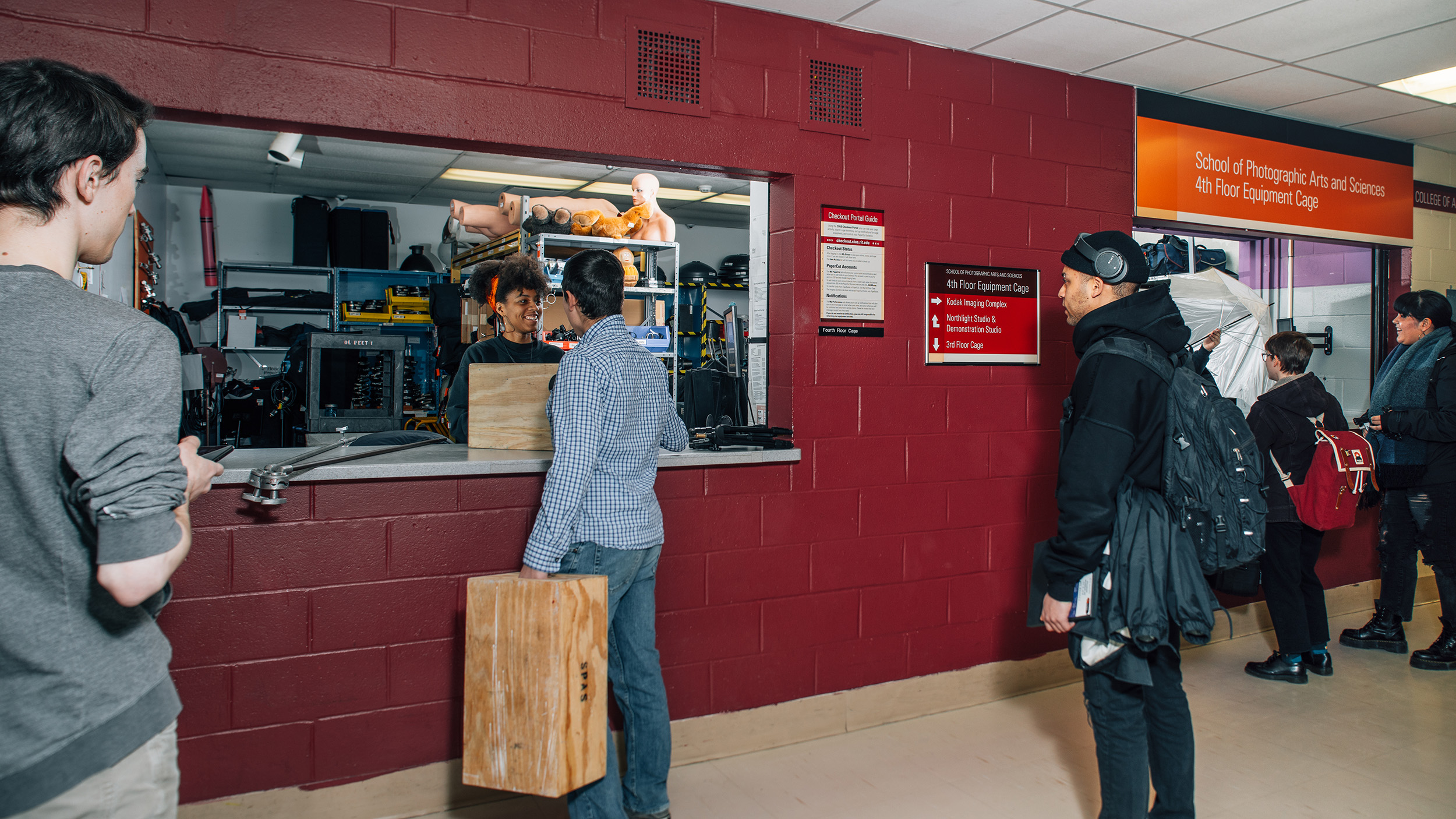 Students check out equipment at the Fourth Floor Cage