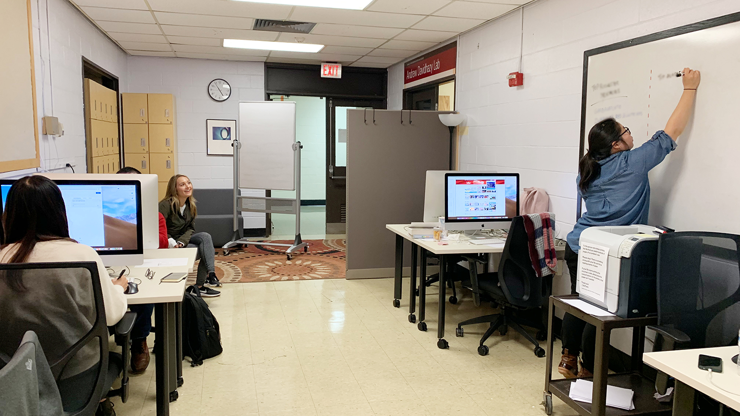 Students working and interacting in a lab space