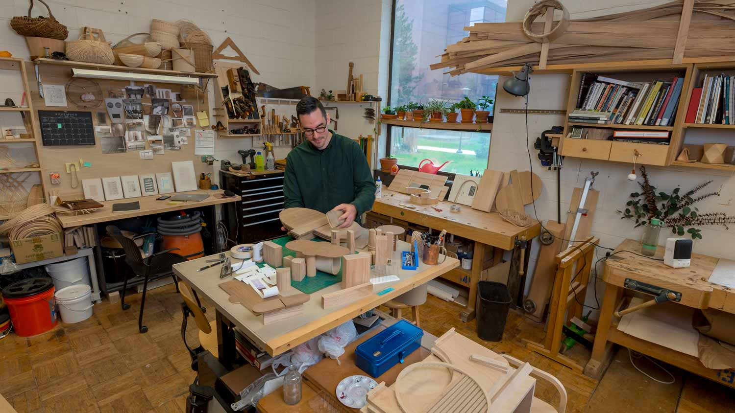 Graduate student working in a woodworking shop.