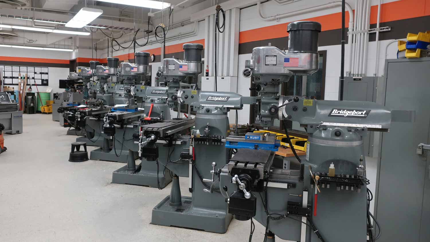 A row of machining tools in a workshop