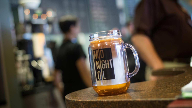 A midnight oil masonry glass mug sitting on a countertop