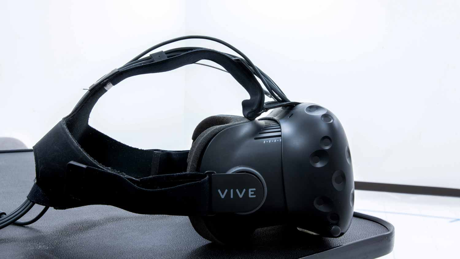 A vive virtual reality headset sitting on a table