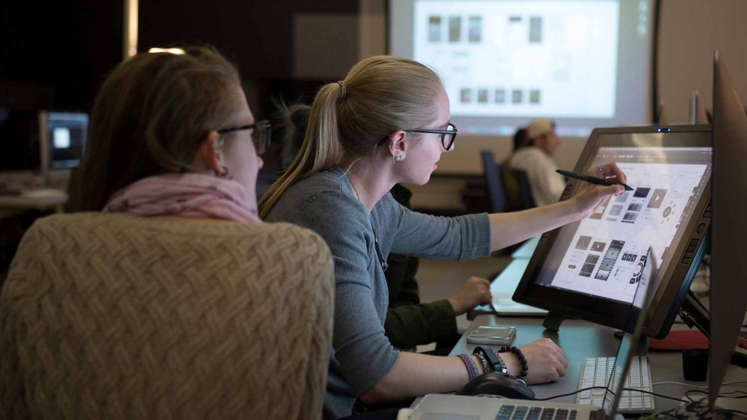 Two female students creating digital art