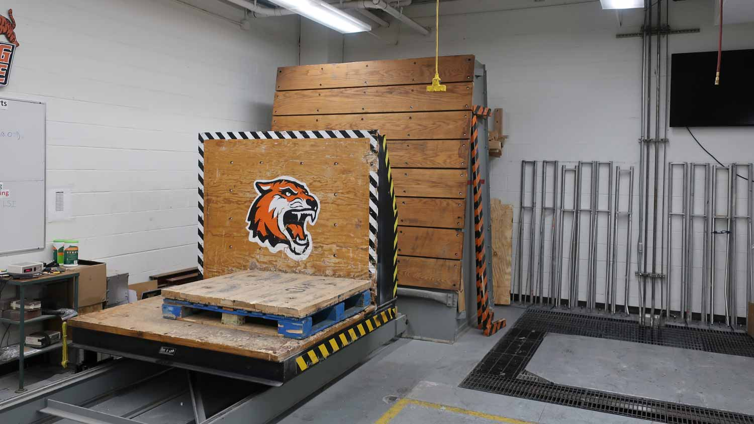 Lab with a wooden block with an RIT tiger face on it