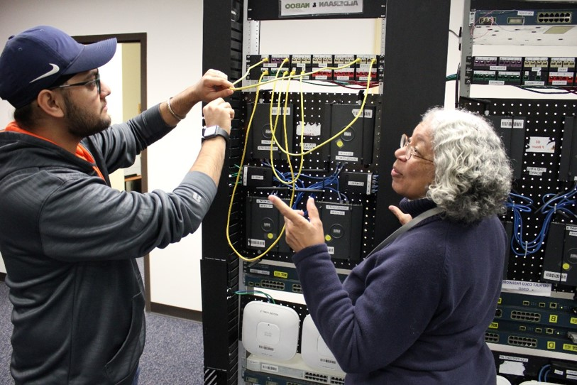A student and a professor Sylvia Perez-Hardy from the School of Information working in the Networking Lab.