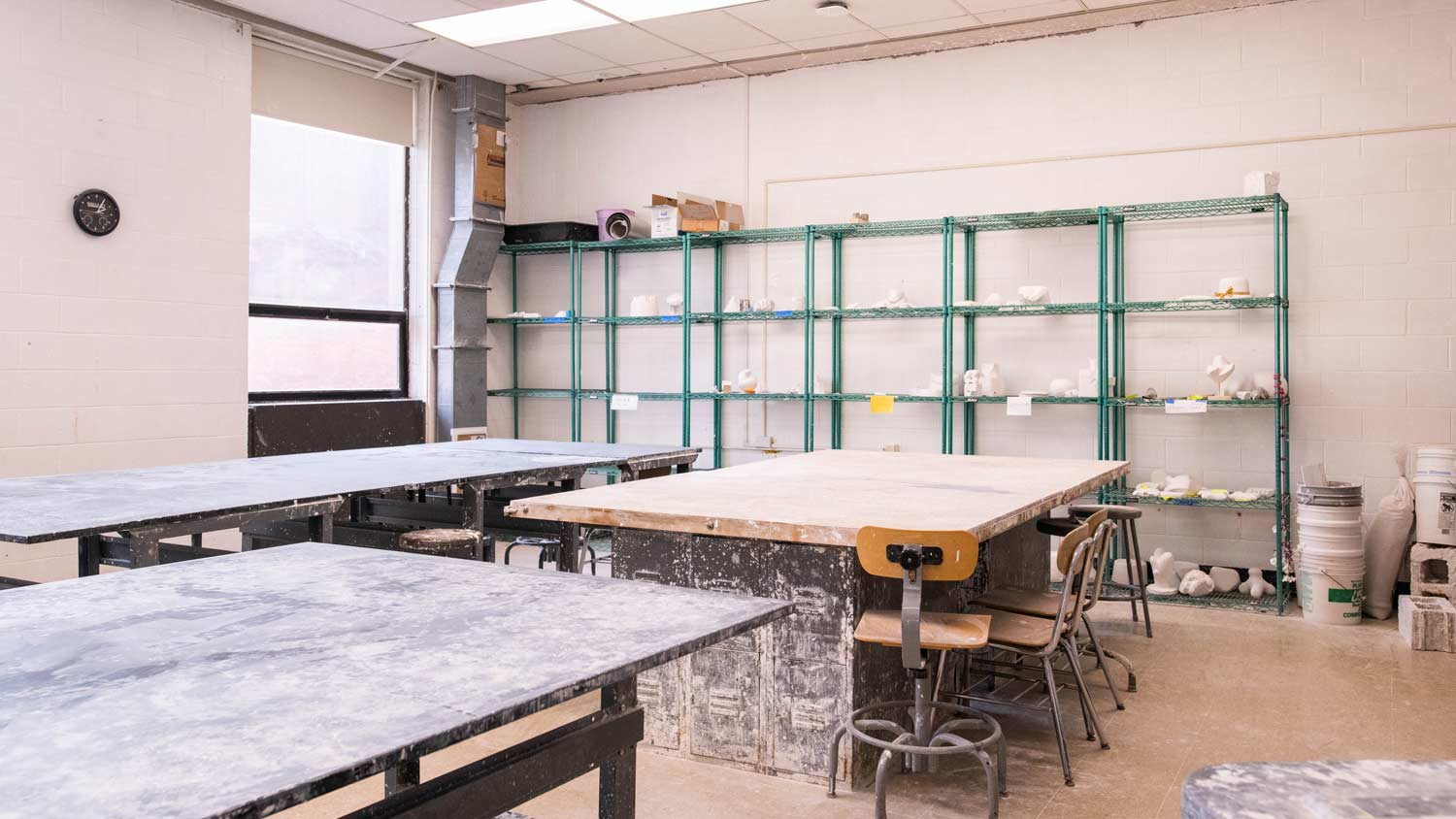 Plaster carving room with large work tables