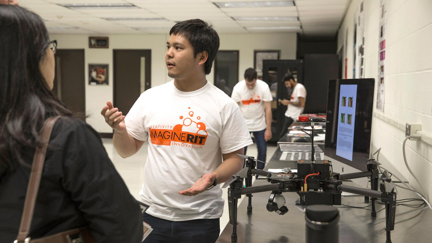 Student demonstrating his drone at Imagine RIT