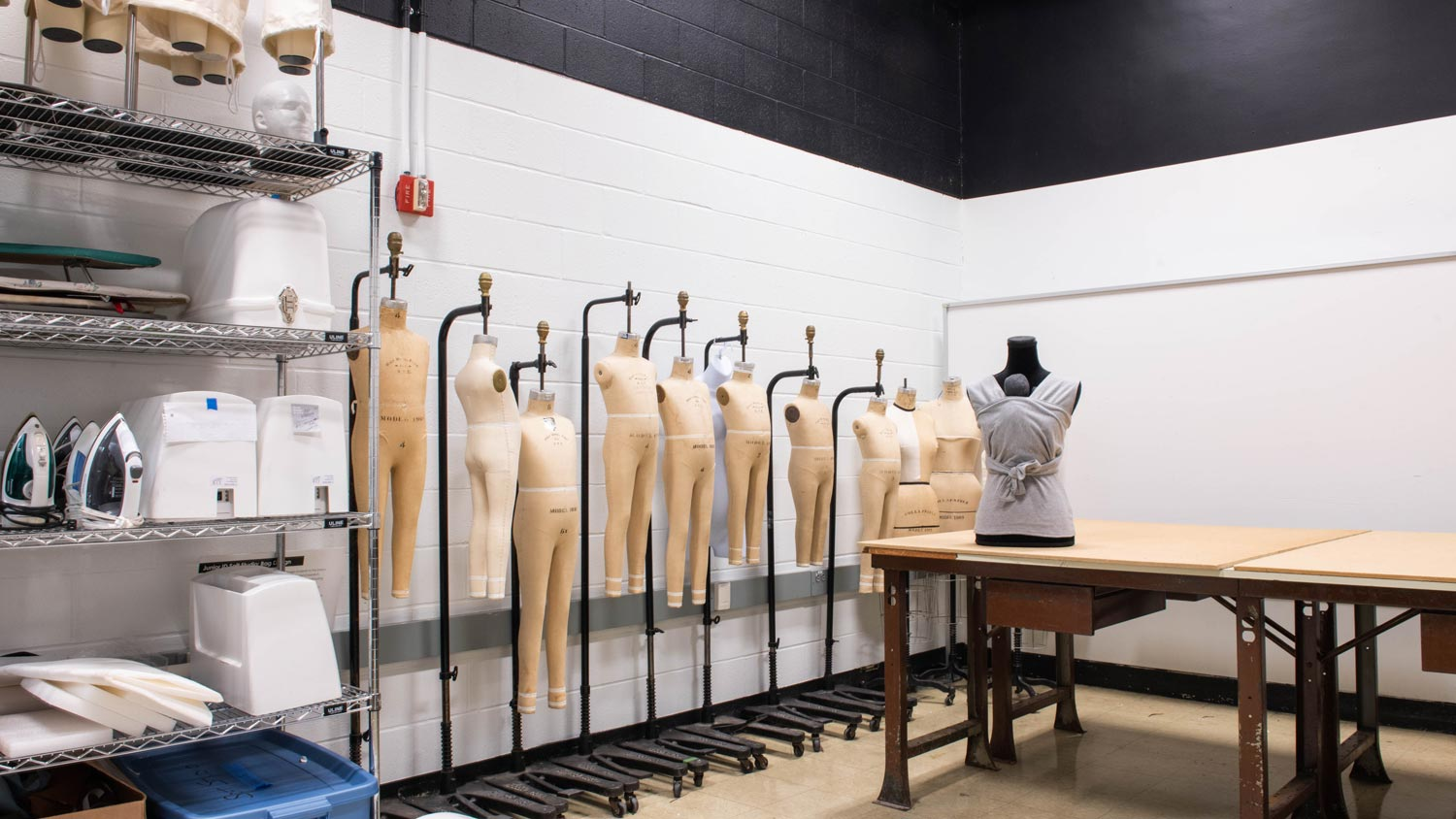 Room with clothing mannequins ready to be dressed