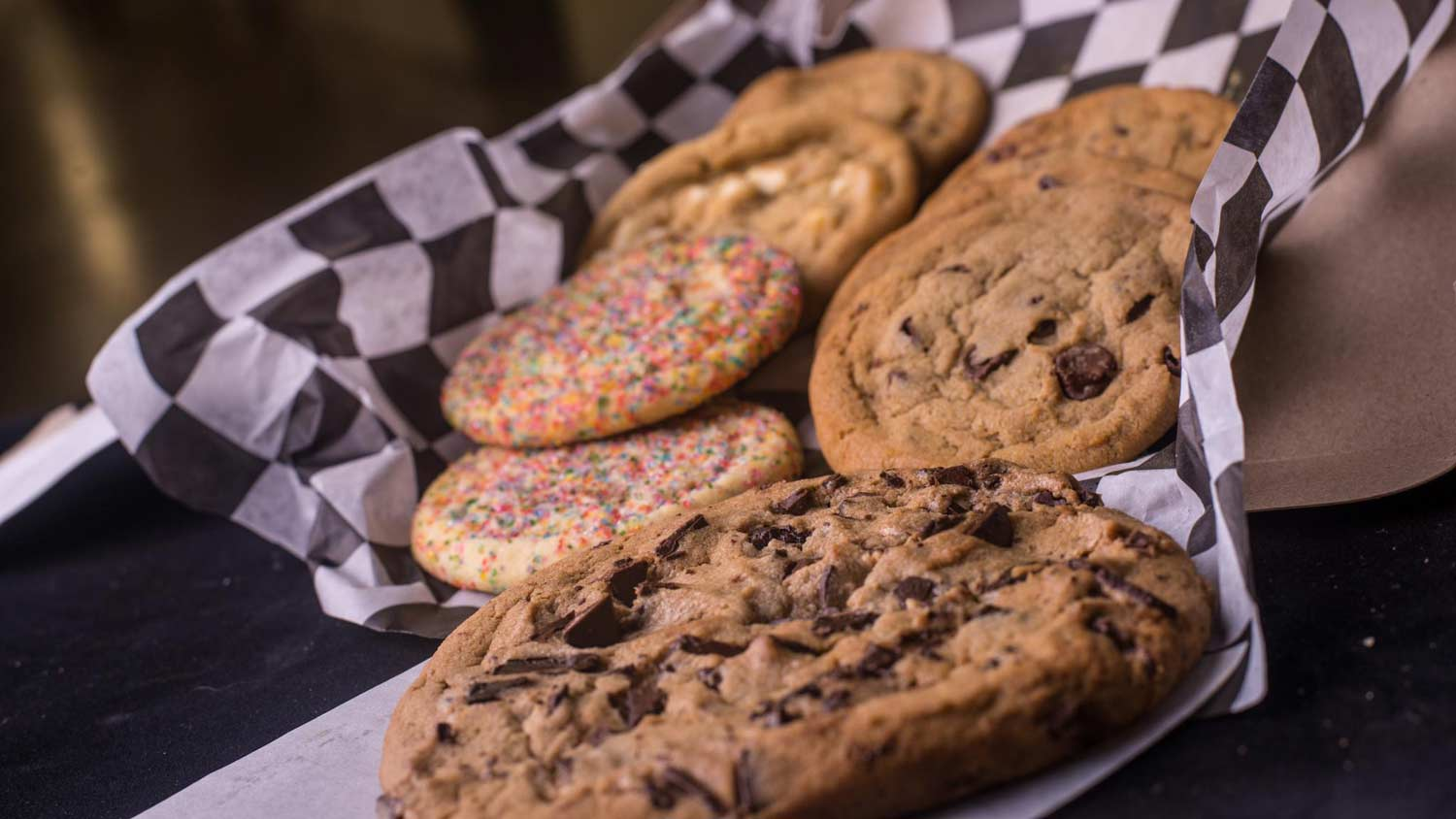 A display of cookies in checkered tissue paper