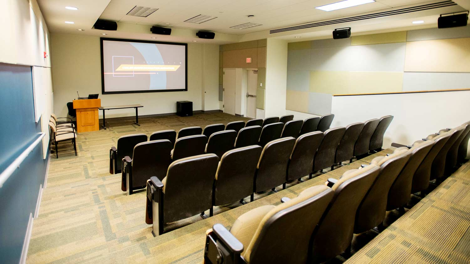 Classroom with stadium seating and a large projector