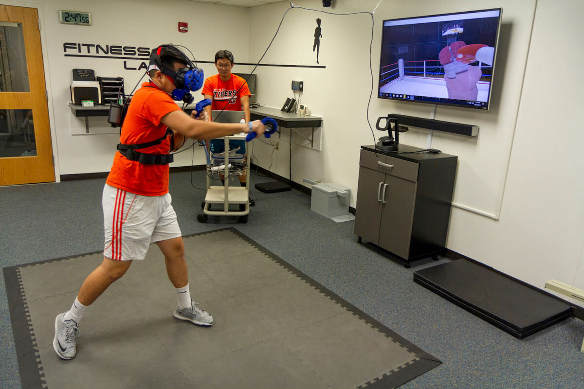 Student engaged in virtual reality boxing.