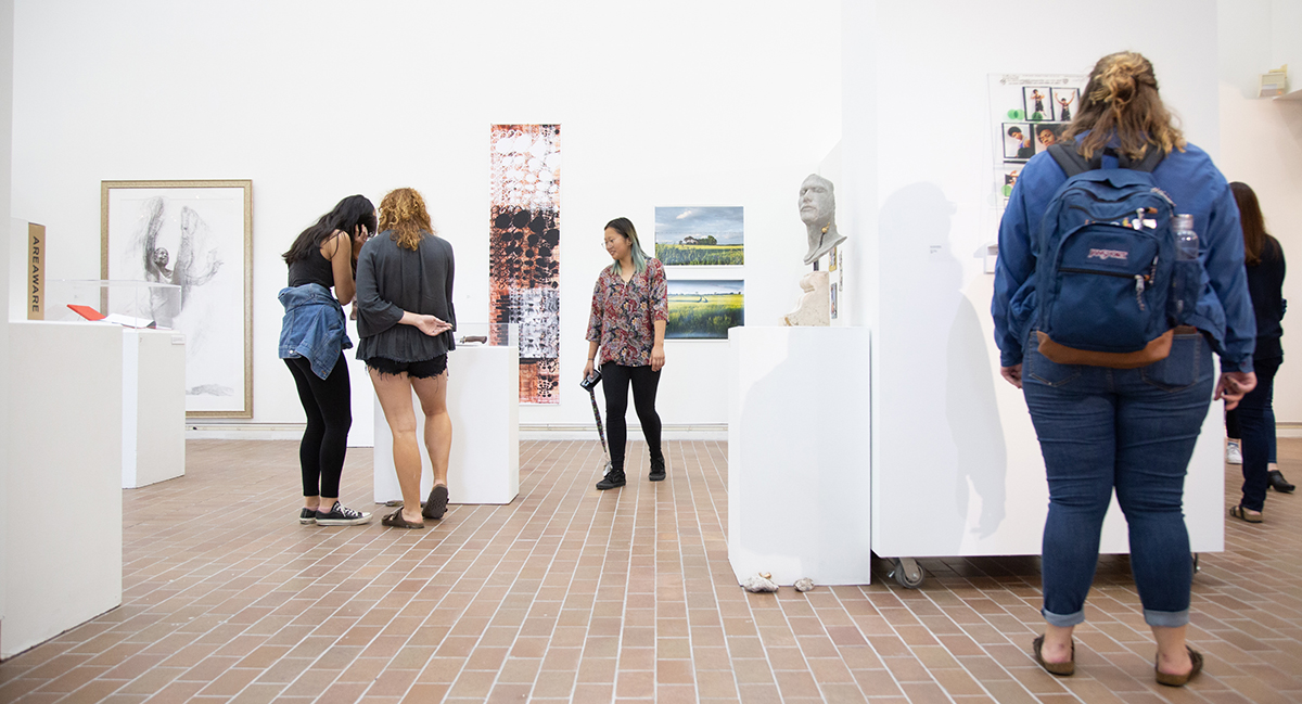 Students view work in Bevier Gallery. Photo by Matteo Bracco.