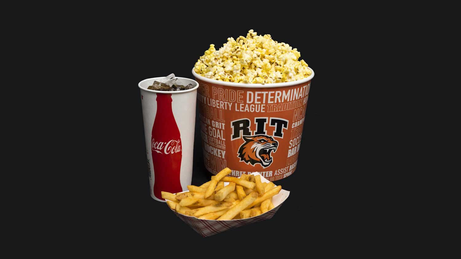 Fries, popcorn, and a fountain drink on a black background
