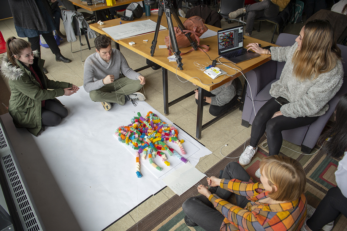 An overhead photo of students making a stop-motion video. Photo by Elizabeth Lamark.