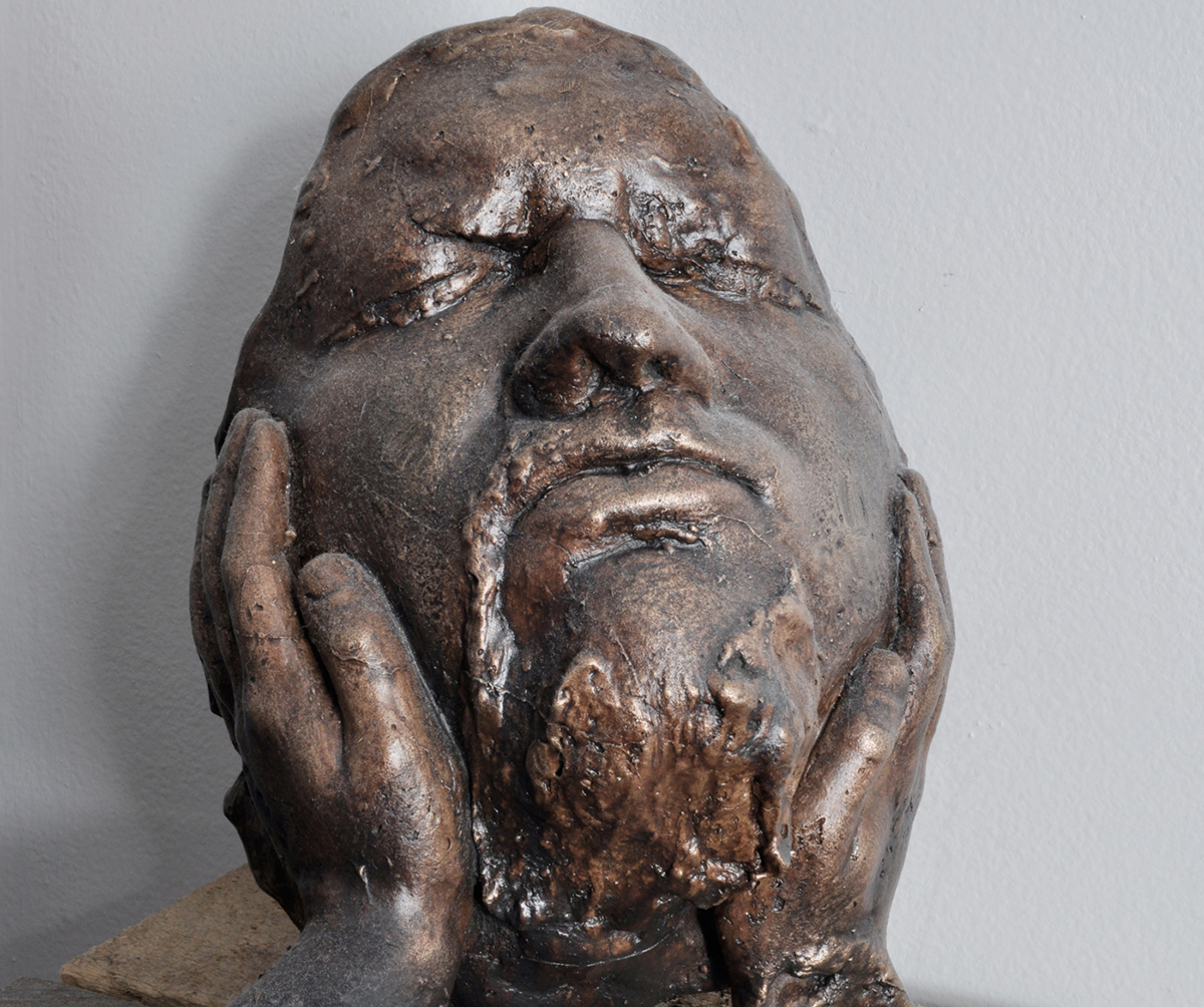 A bronze sculpture of a face.