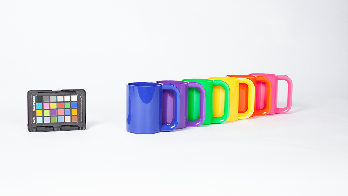 Vignelli-designed mugs of various colors Brookstone shopping bags for the Vignelli digital image archive.