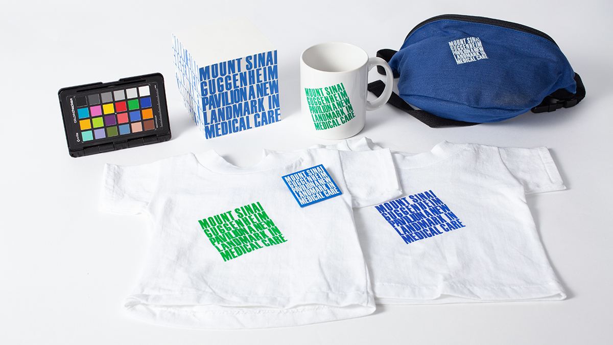 Vignelli-designed shirts, mug and bag Brookstone shopping bags for the Vignelli digital image archive.