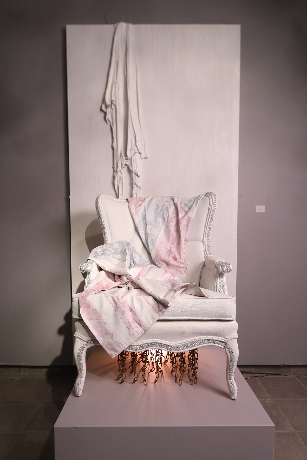A found object sculpture incorporating a chair.