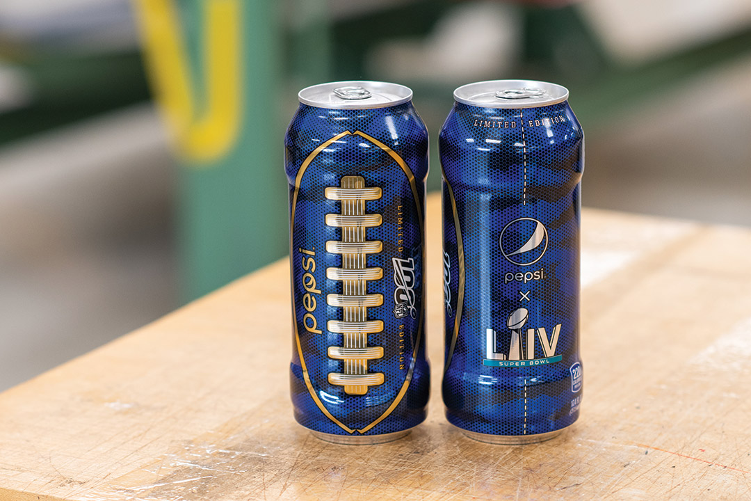 two special edition Pepsi cans with football laces.