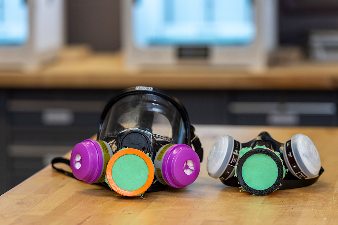 chemical respirators with covers on the valves.