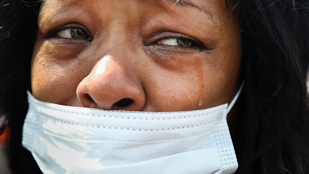 A close-up photo of a woman shedding tears.