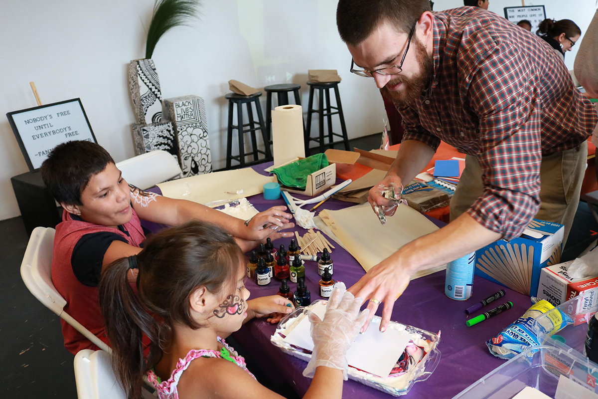 Dan Pfohl creates art with local youth.