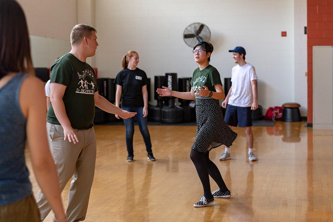 Students swing dance.