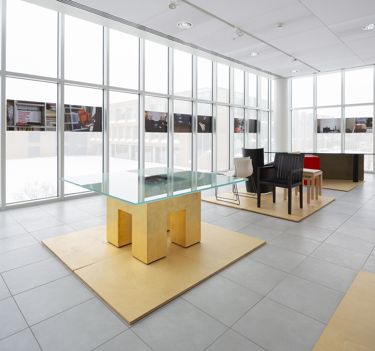 A display of photos of the Vignellis hangs in the Vignelli Center.