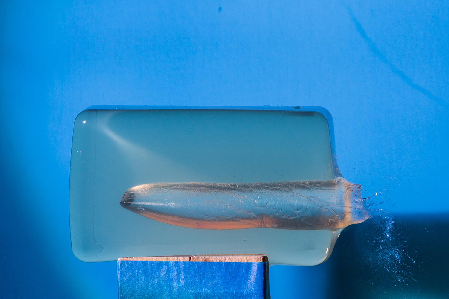 A photo of a bullet going through jello