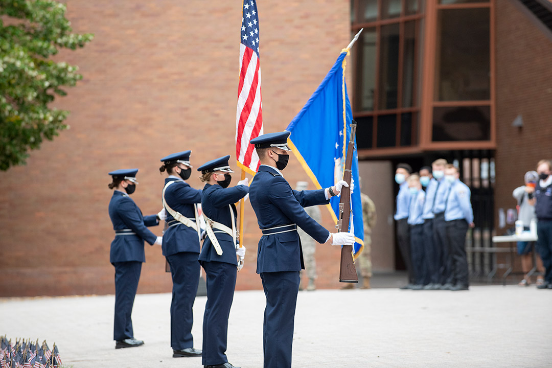 ROTC color guard members displaying flags.