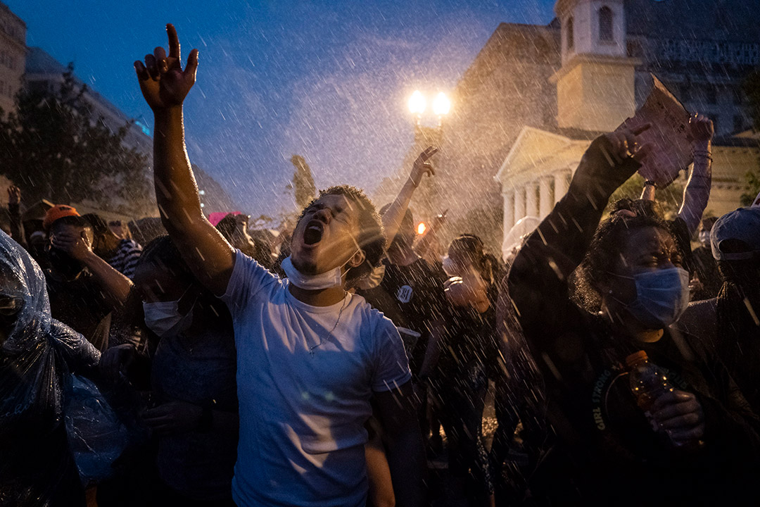 crowd of protestors in the rain.