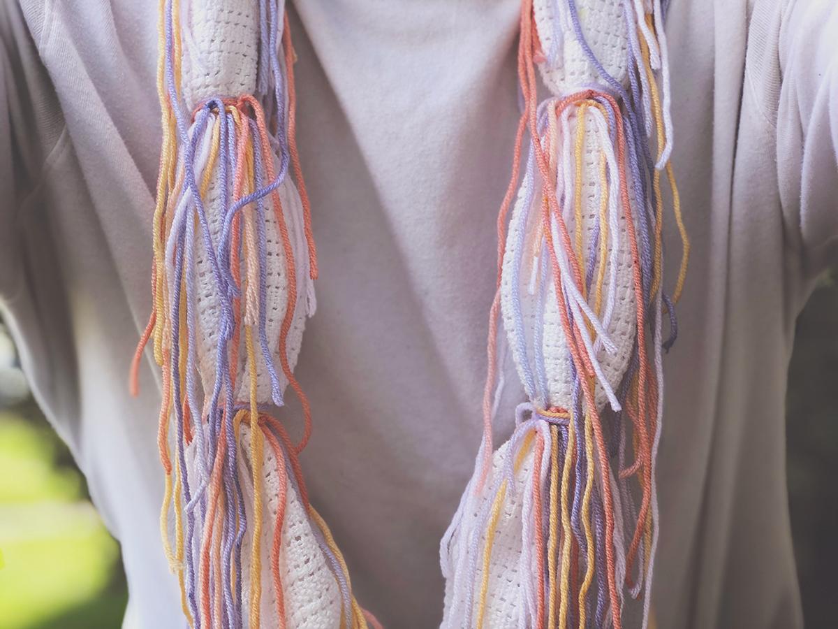 A multi-colored cloth necklace.