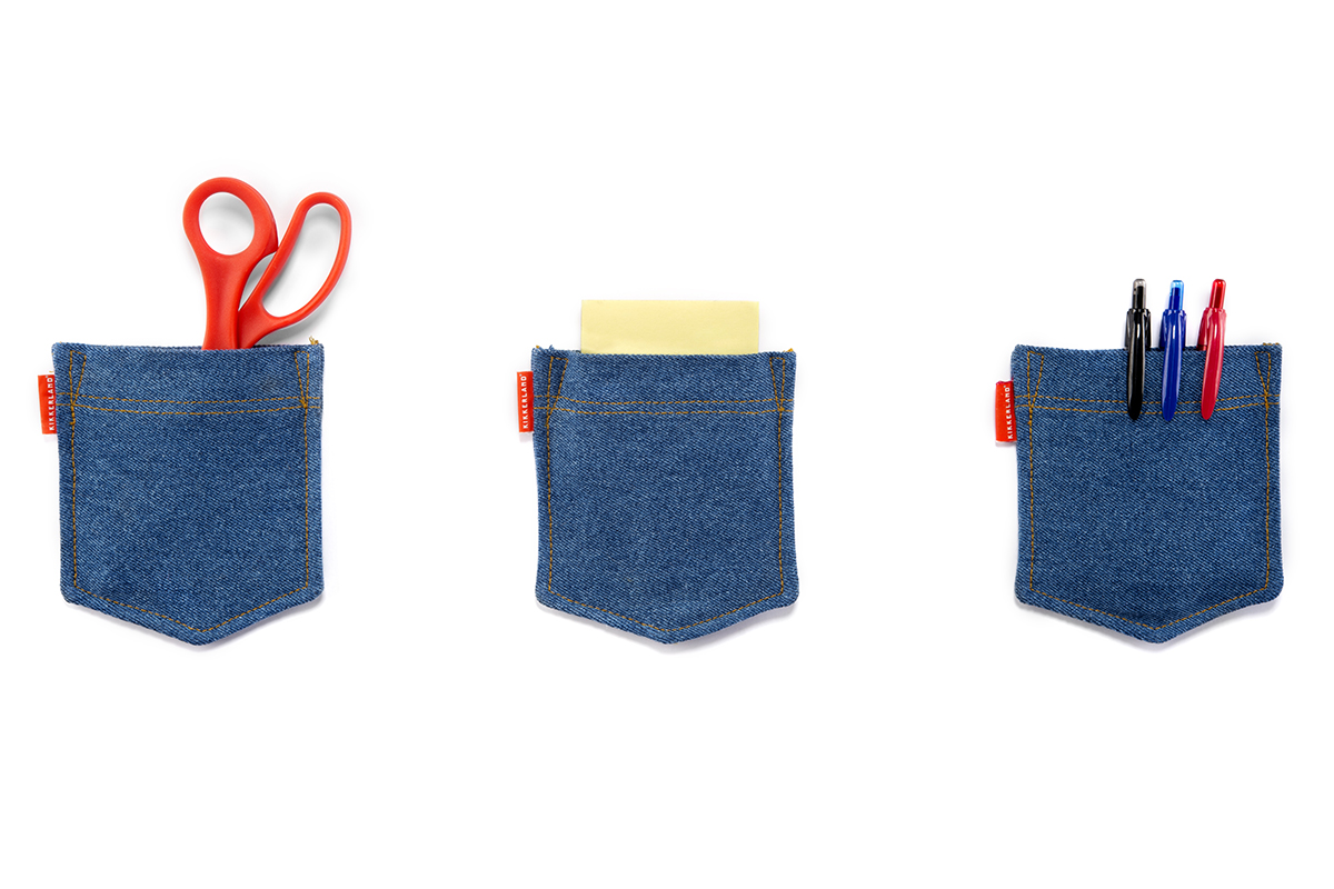 Denim pockets holding practical items like scissors and pens