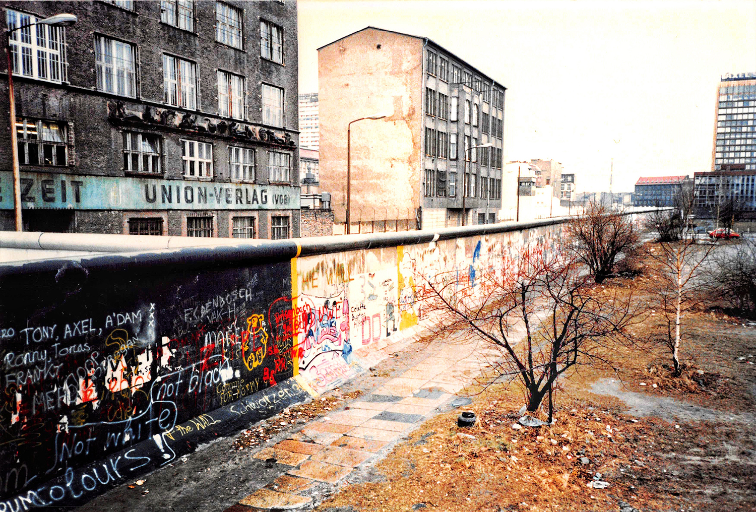 A photo of the Berlin Wall, painted with graffiti.