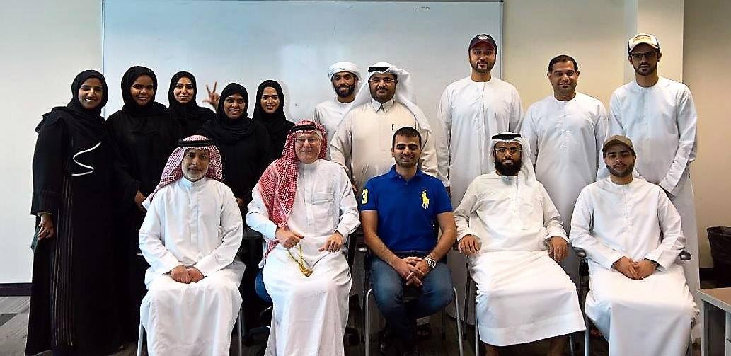 men and women posing for a photo in Dubai.