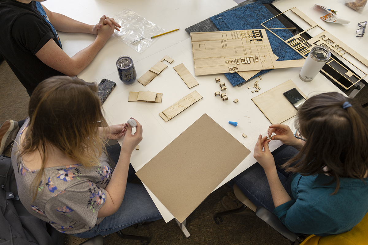 An overhead photo of Interior Design students working collaboratively in the studio.