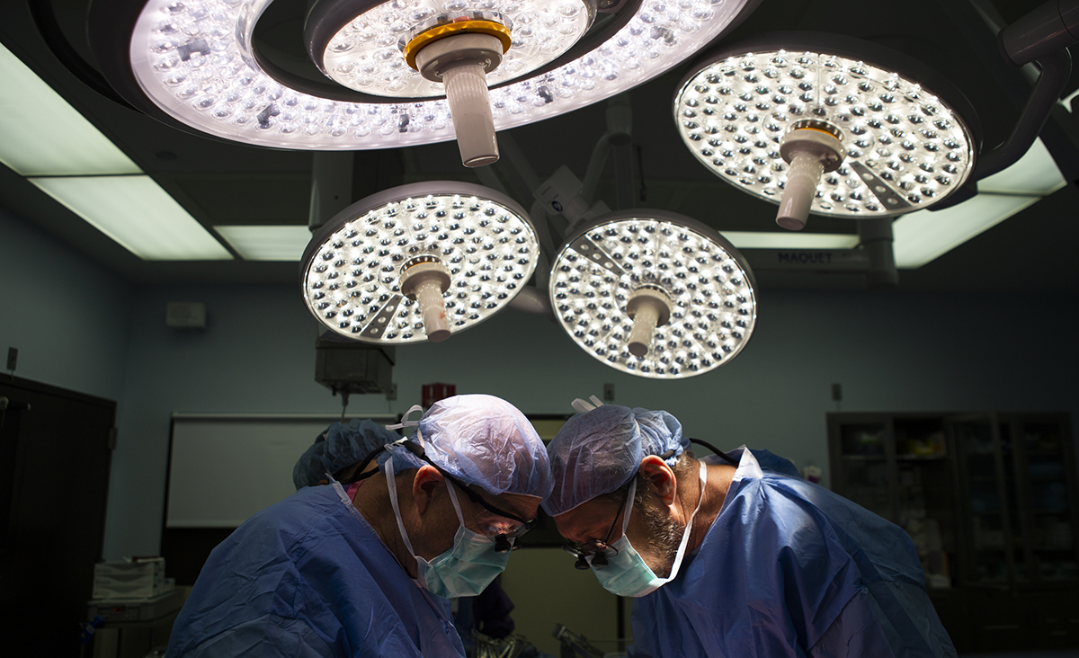 Two medical personnel in an operating room.