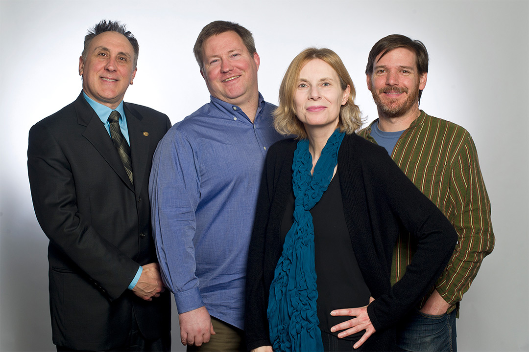 Group of four researchers standing.