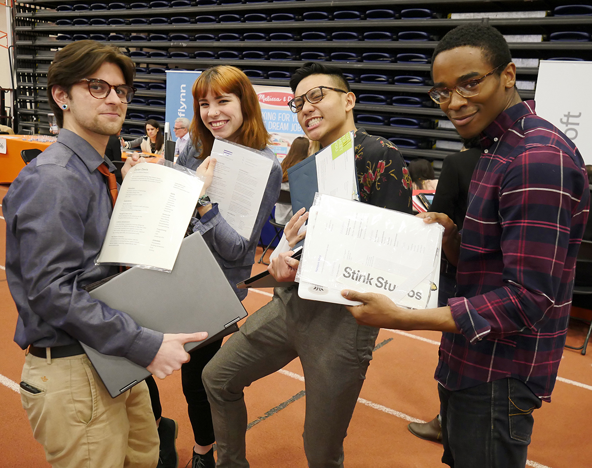 Students show off their resumes and portfolios at Creative Industry
